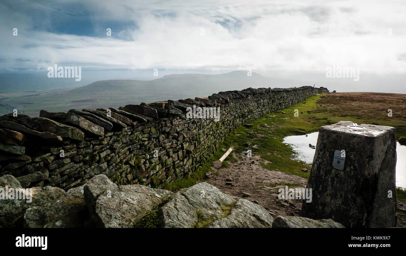 Trig point on summit of Whernside, 3 peaks, Yorkshire Dales, England, UK - Stock Image