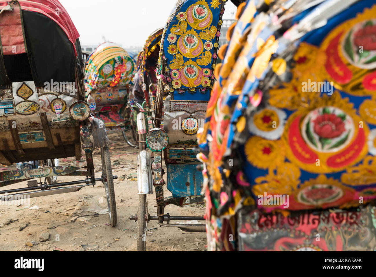 A ine of rickshaws parked on a roadside at Dhaka Bangladesh - Stock Image