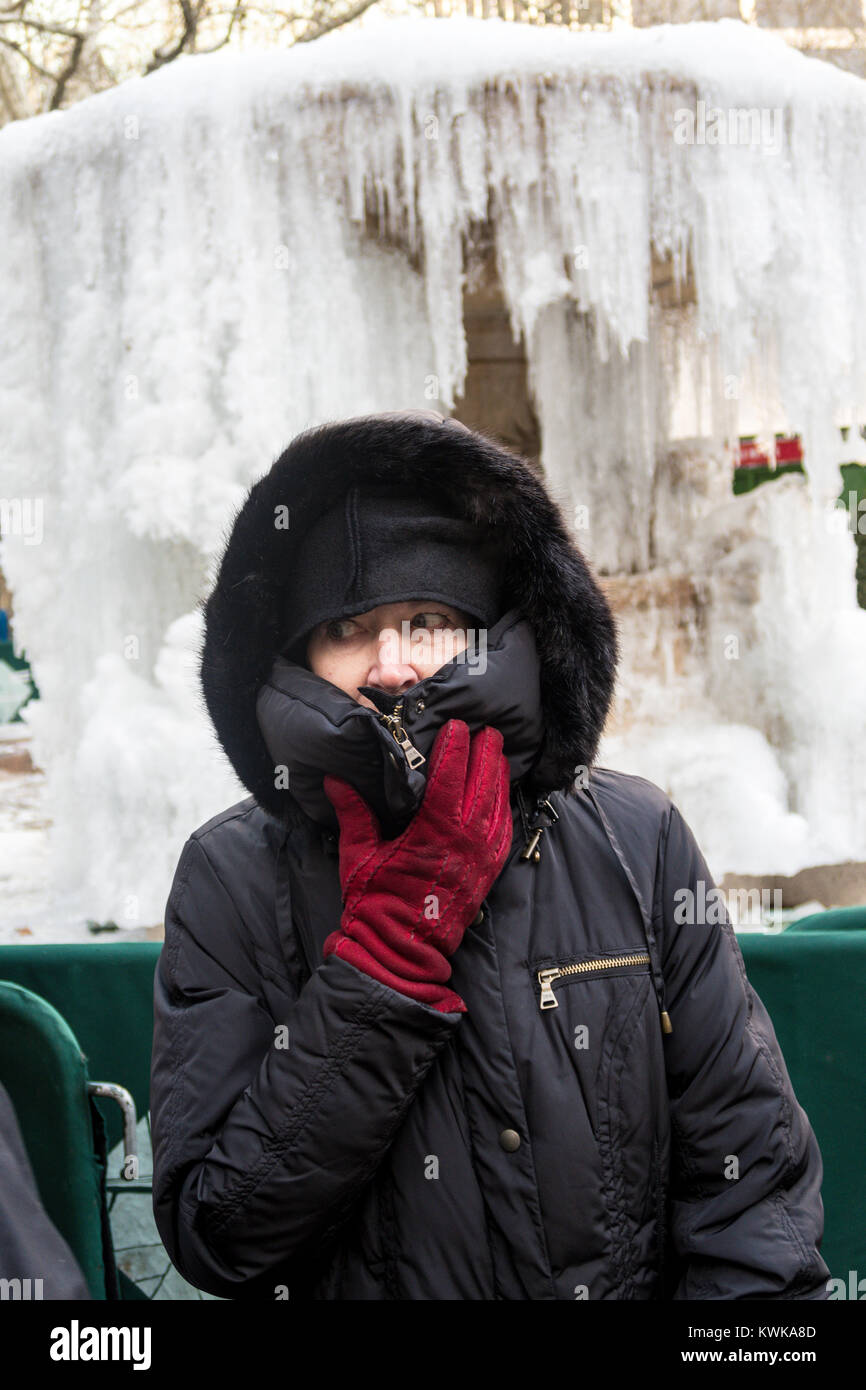 Senior Woman in front of the Frozen Josephine Shaw Lowell Memorial Fountain in Bryant Park, NYC, USA - Stock Image