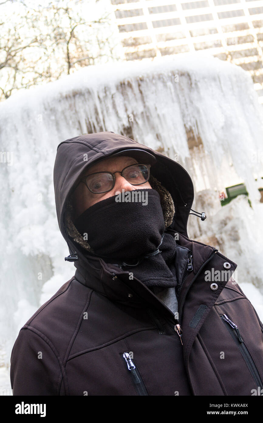 Senior Man in front of the Frozen Josephine Shaw Lowell Memorial Fountain in Bryant Park, NYC, USA - Stock Image