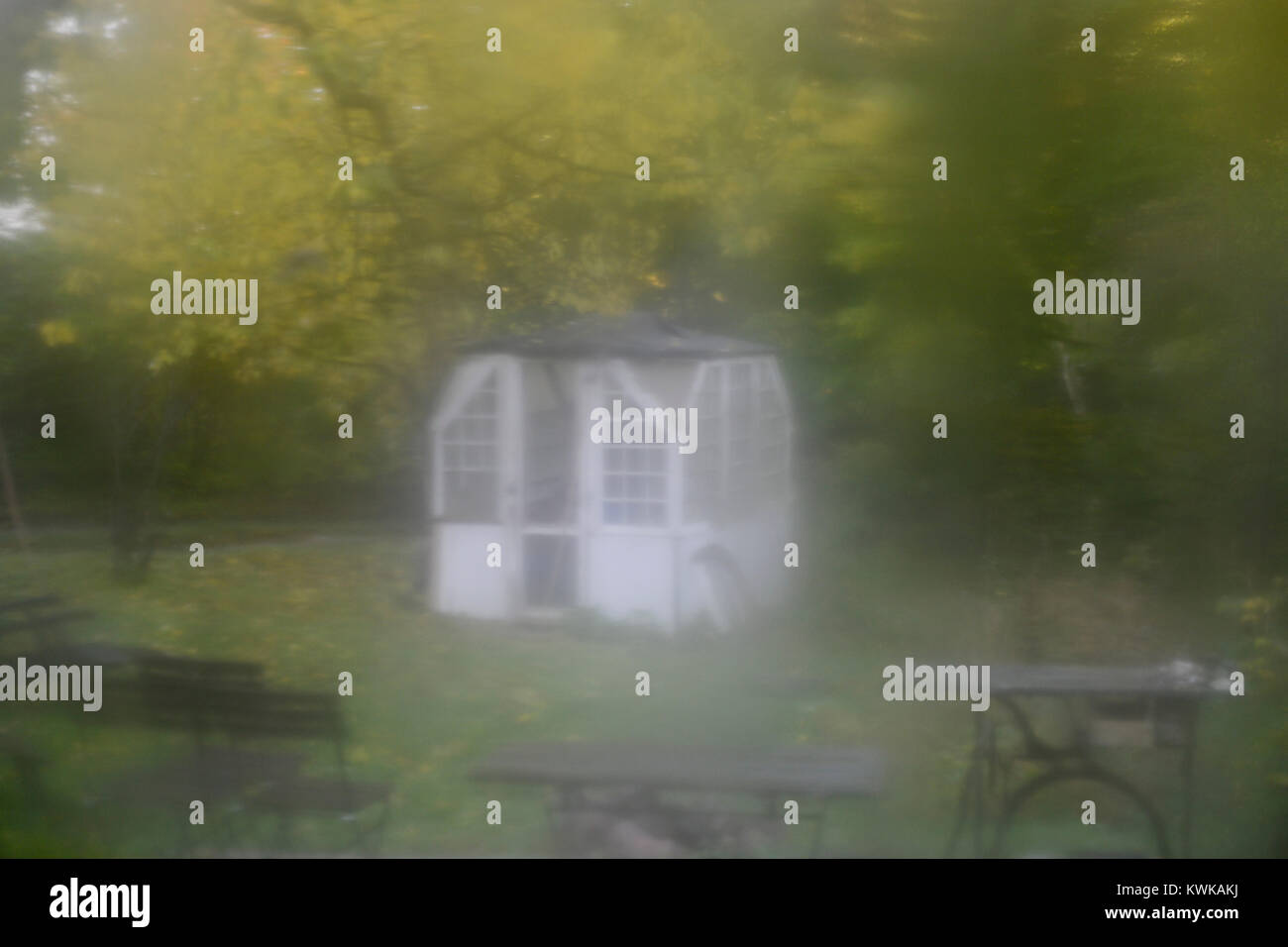 GERMANY, baltic sea, island Ruegen, look at garden pavillon, out of focus, seen through damp window - Stock Image