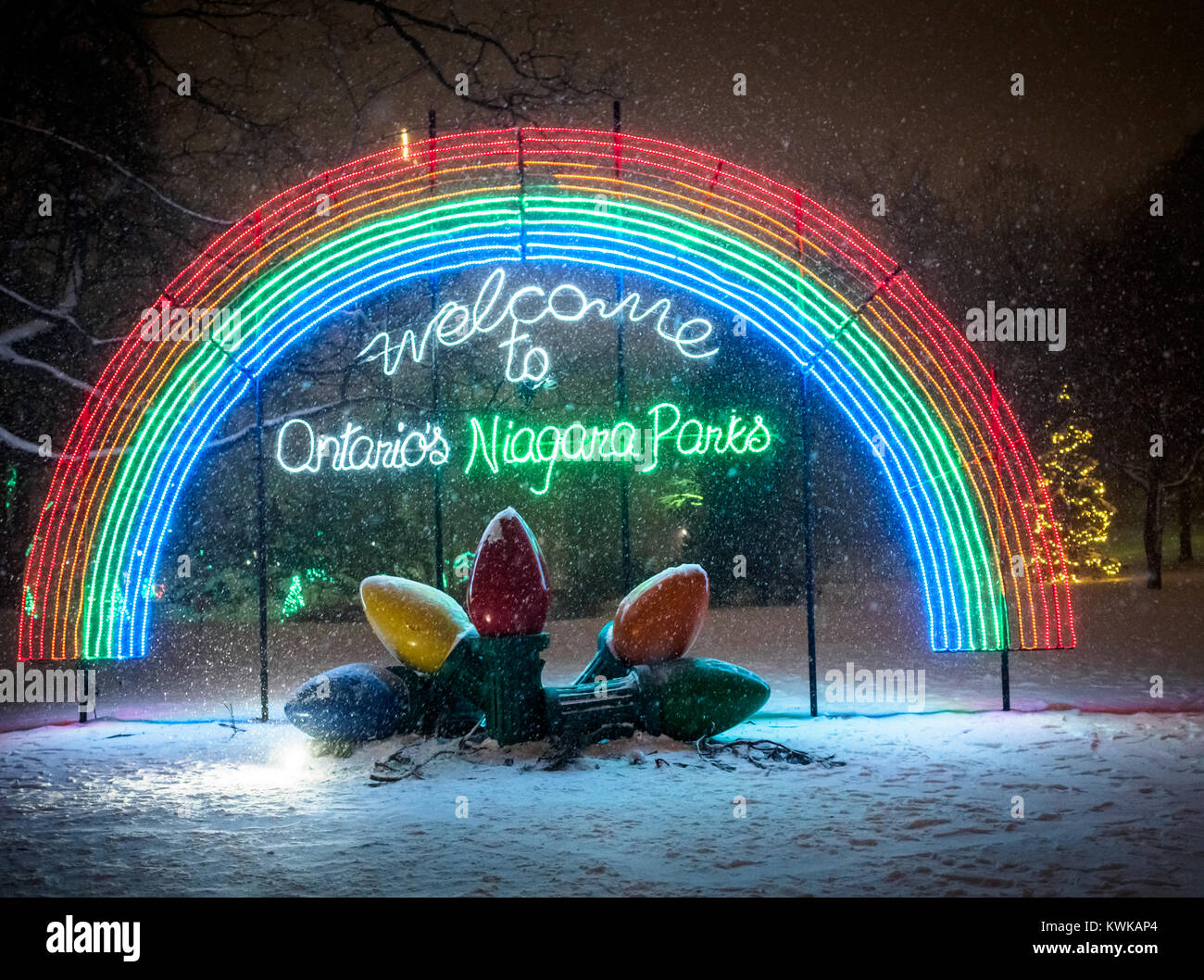 Winter festival of lights showing illuminated lights forming a rainbow at Ontario's Niagara Parks on a snowy - Stock Image