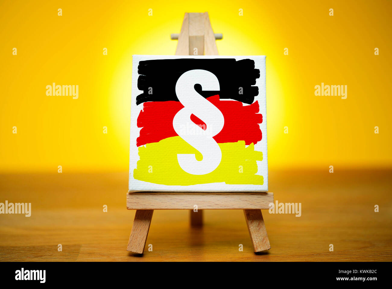 Picture with section sign on an easel, symbolic photo cultural asset law for the protection, Bild mit Paragraphenzeichen - Stock Image