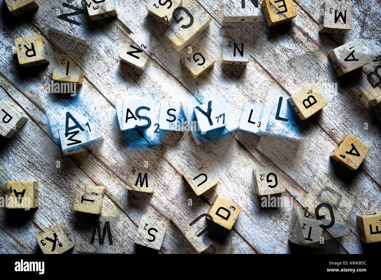 Letter cubes form the word Asylum, Buchstabenw?rfel formen das Wort Asyl - Stock Image