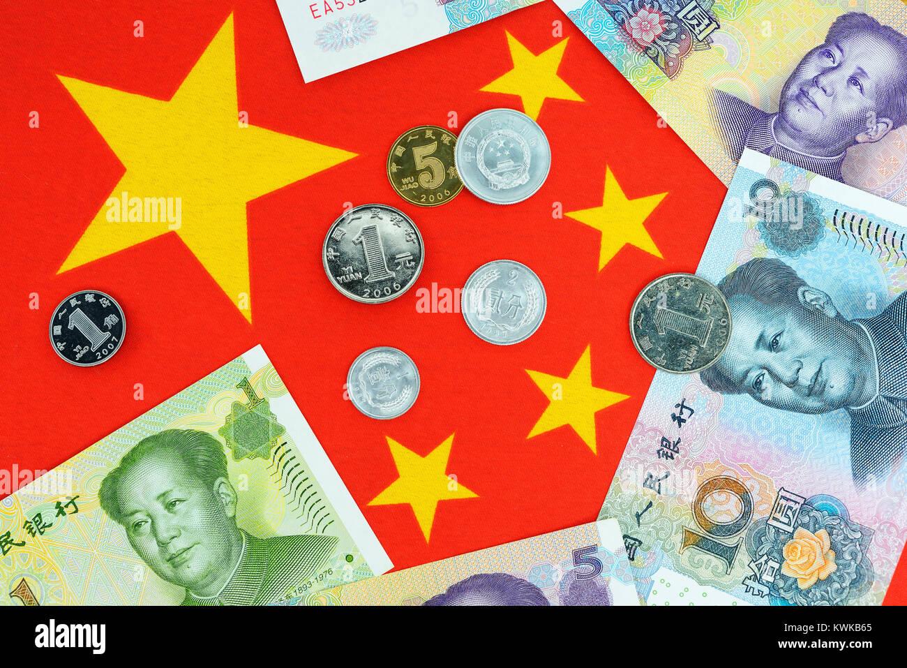 Chinese currency Renminbi on the Chinese national flag, Chinesische W?hrung Renminbi auf der chinesischen Nationalflagge - Stock Image