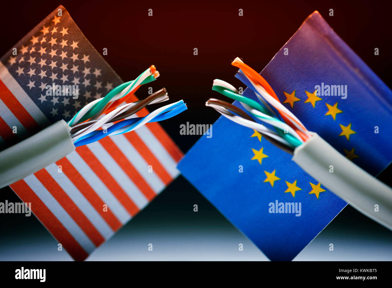 Cut Internet cable with flags of the USA and the EU, data protection agreement safe Harbor invalid, Durchgeschnittenes Stock Photo