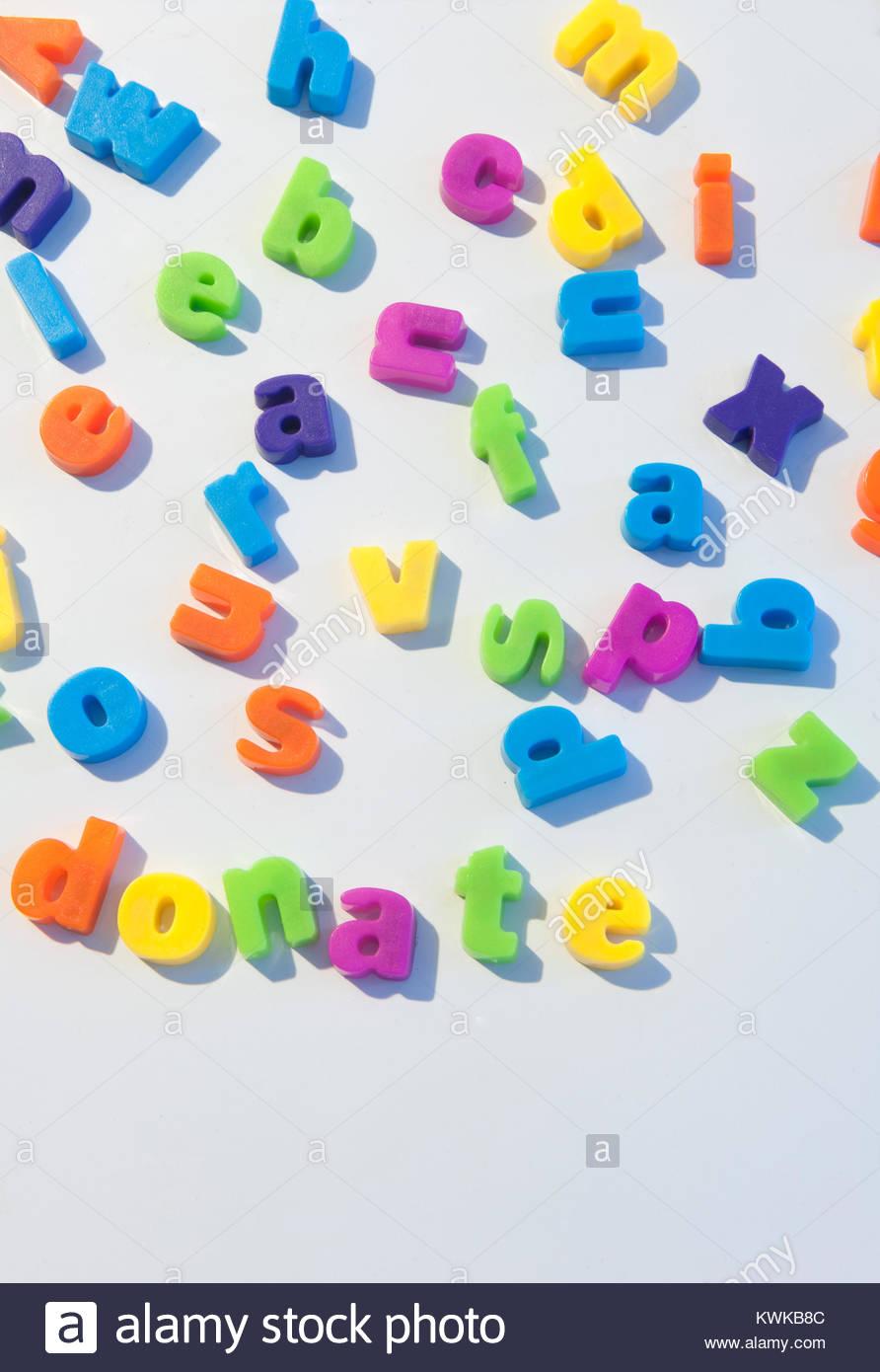 fridge magnet letters spell donate stock image