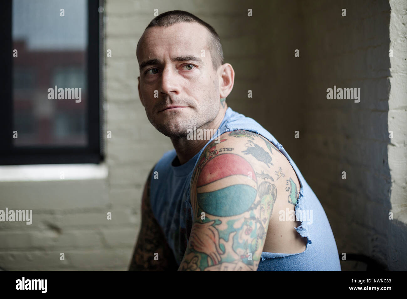 Former WWF Wrestler, CM Punk (Phil Brooks) photographed at his apartment in Milwaukee. - Stock Image