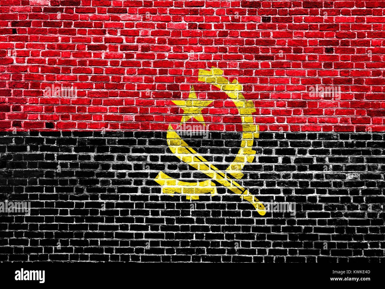 Flag of Angola painted on brick wall, background texture - Stock Image