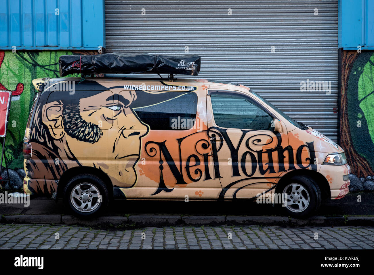 82d73f4f1c Campervan owned by the hire company Wicked Campers and decorated with the  face of singer-