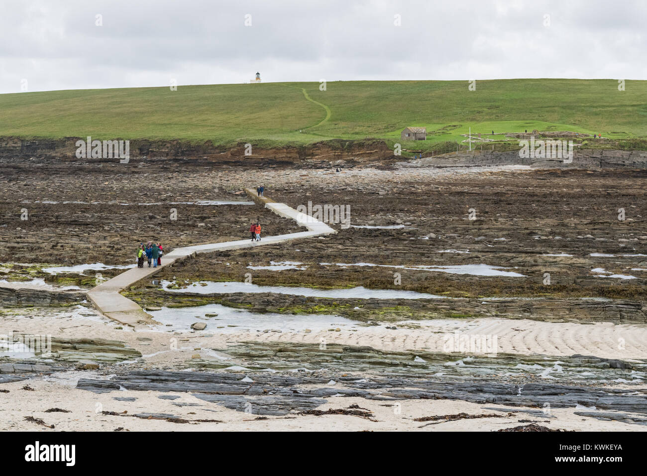 Causeway leading to the tidal island of Brough of Birsay, Mainland Orkney, Scotland, at low tide Stock Photo