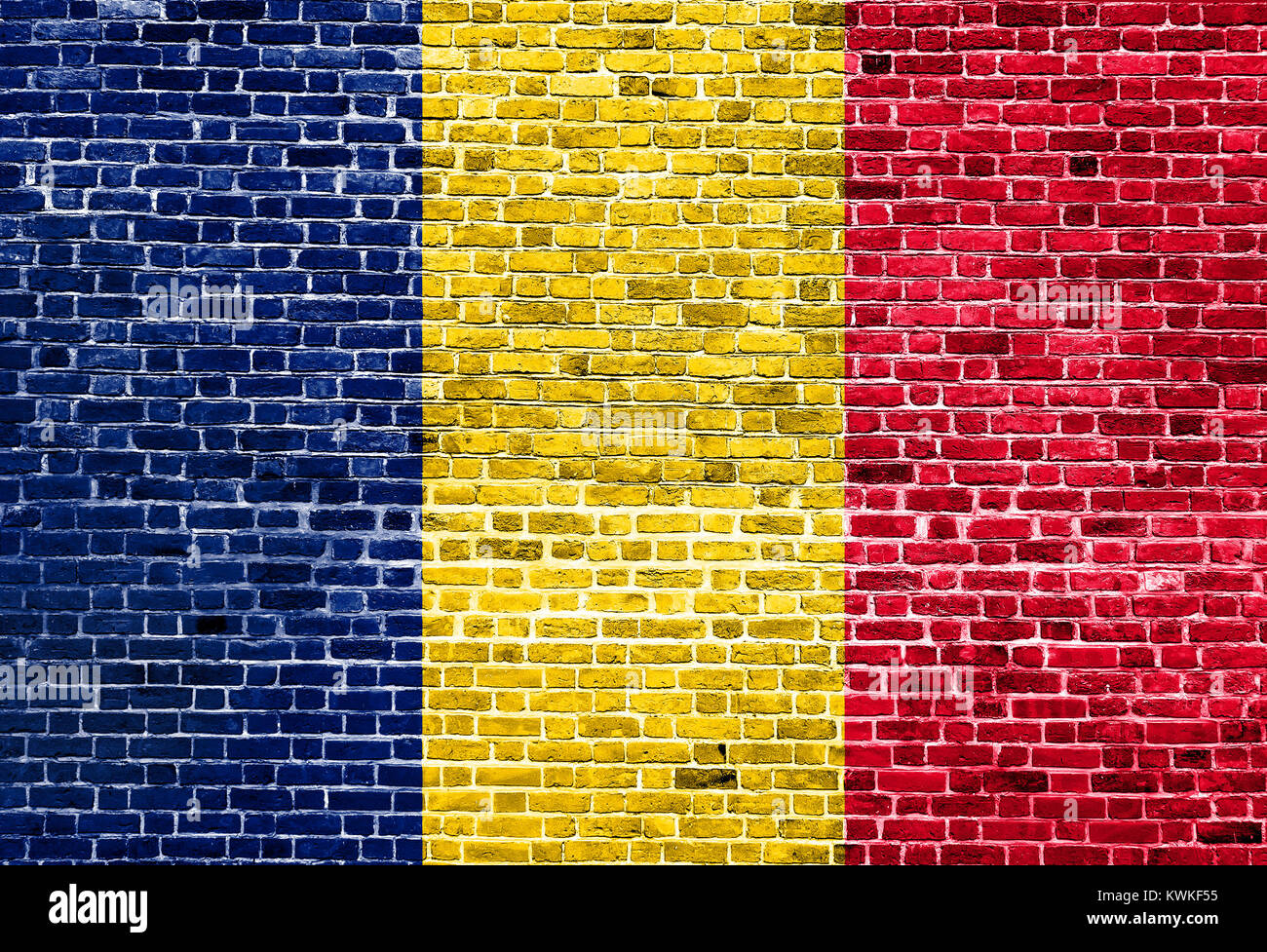 Flag of Chad painted on brick wall, background texture - Stock Image