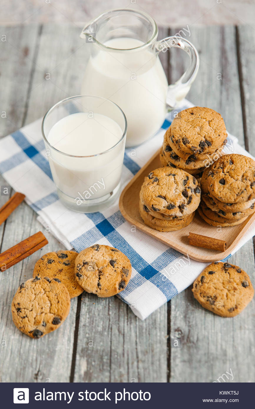 High angle view of cookies and milk on table - Stock Image