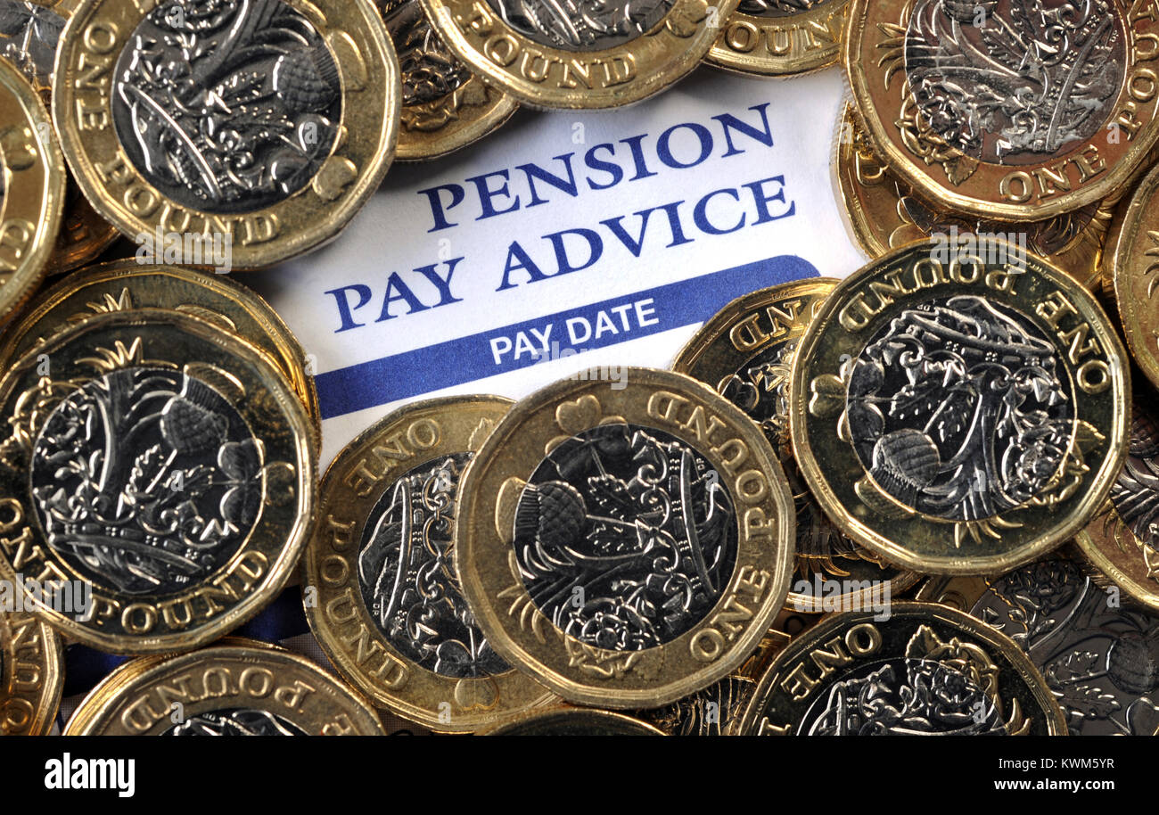 COMPANY PENSION PAY ADVICE WITH NEW ONE POUND COINS RE PENSIONS INCOMES RETIREMENT SAVINGS  ETC UK - Stock Image