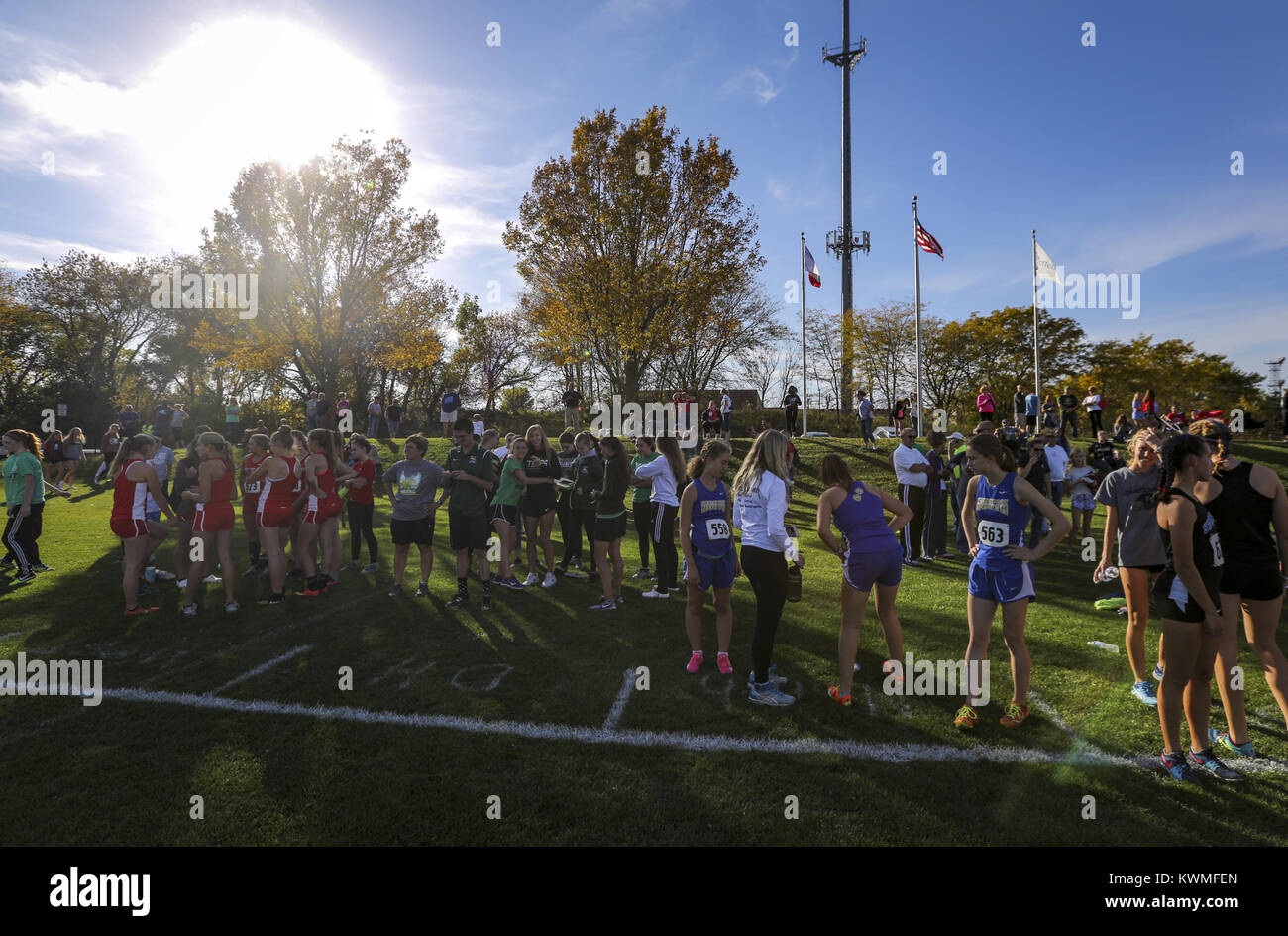 October 19, 2017 - Bettendorf, Iowa, U.S. - Runners stretch and get ready for their race during the 4A state cross - Stock Image