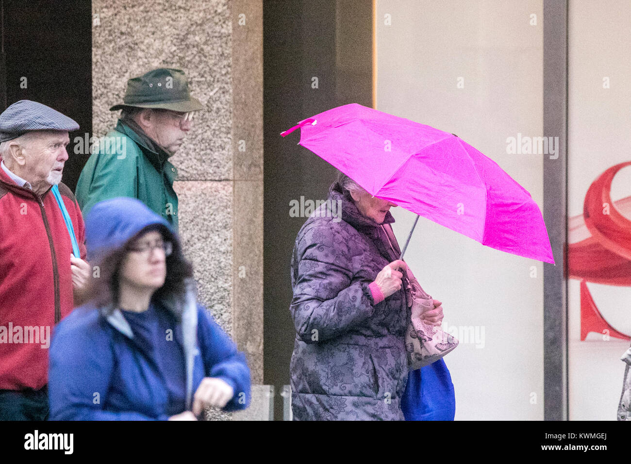 Southport, Merseyside. 4th jan, 2018. UK Weather: Heavy rain pours down on hardy shoppers venturing into Southport - Stock Image