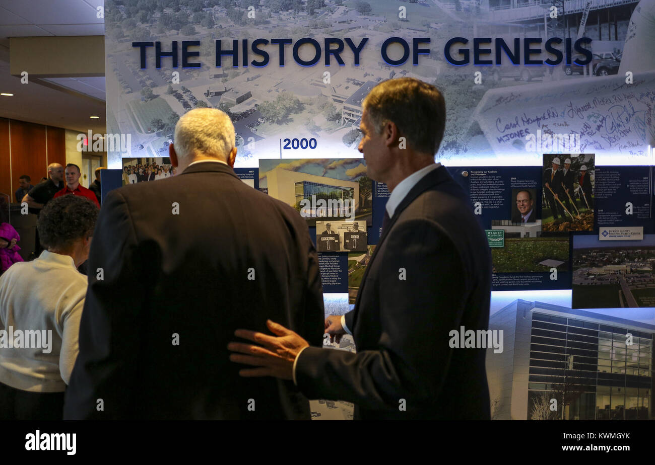 Davenport, Iowa, USA. 7th Dec, 2017. Guests walk by the timeline of various historical photos, articles and artifacts - Stock Image