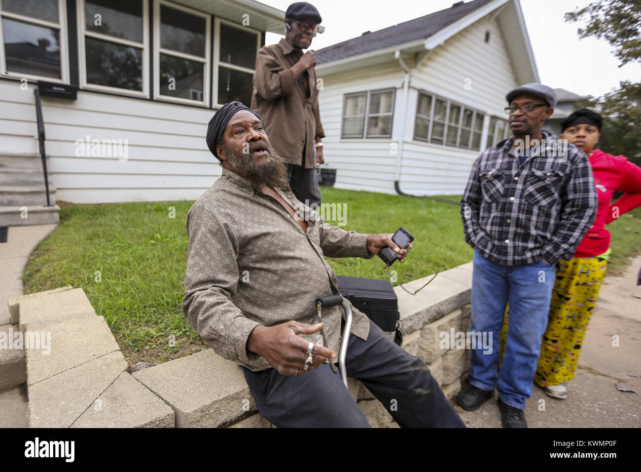 Rock Island, Iowa, USA. 12th Oct, 2017. Resident Lester Mark Lewis talks with neighbors exclaiming he, ''got - Stock Image