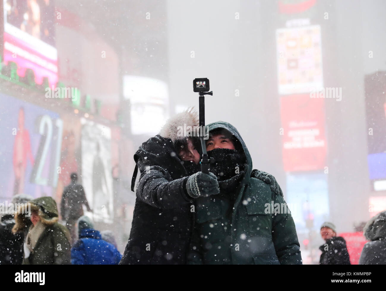 New York, USA. 4th Jan, 2018. People take selfies at Times Square in New York, the United States, Jan. 4, 2018. - Stock Image