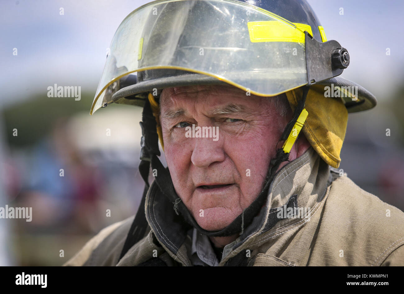 Davenport, Iowa, USA. 6th Aug, 2017. U.S. Secretary of Agriculture Sonny Perdue is seen in firefighter gear while - Stock Image