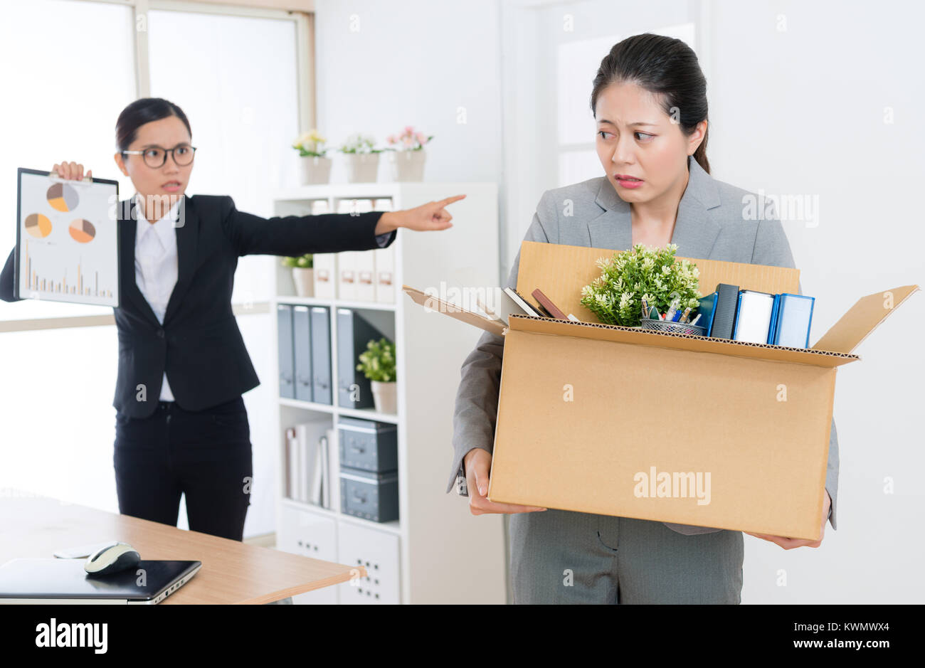 beautiful elegant office worker girl feeling fear when angry pretty business boss woman showing company marketing - Stock Image