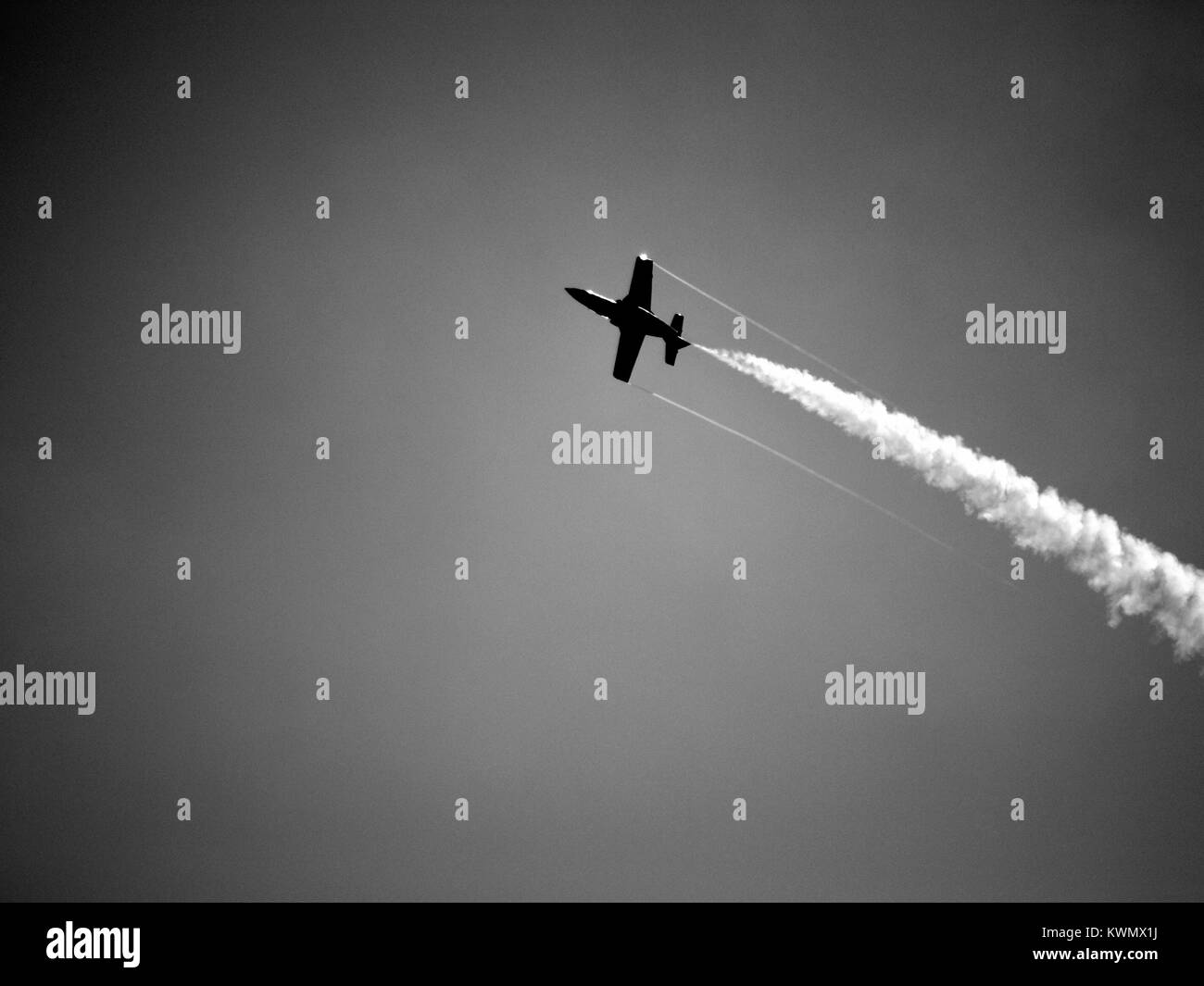 Plane upside down with chemtrail - Stock Image