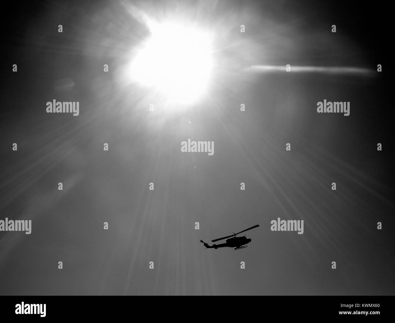 Helicopter under the sun - Stock Image