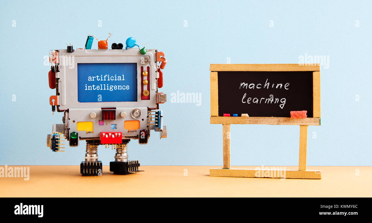 Artificial intelligence machine learning. Robot computer black chalkboard classroom interior, future technology - Stock Image