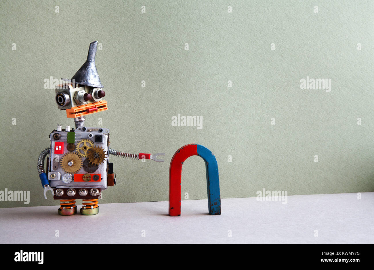 Funny robot red blue horseshoe magnet. Creative design toy funnel hopper, cogs wheels gears silver metallic body. - Stock Image