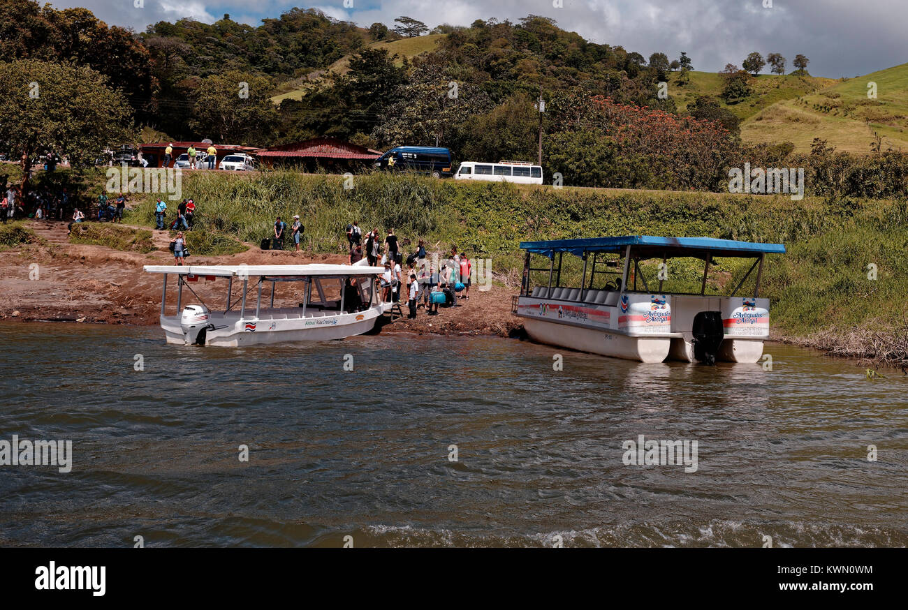 Boats ferrying passengers from La Fortuna land at Monteverde, across Lake Arenal, Costa Rica - Stock Image
