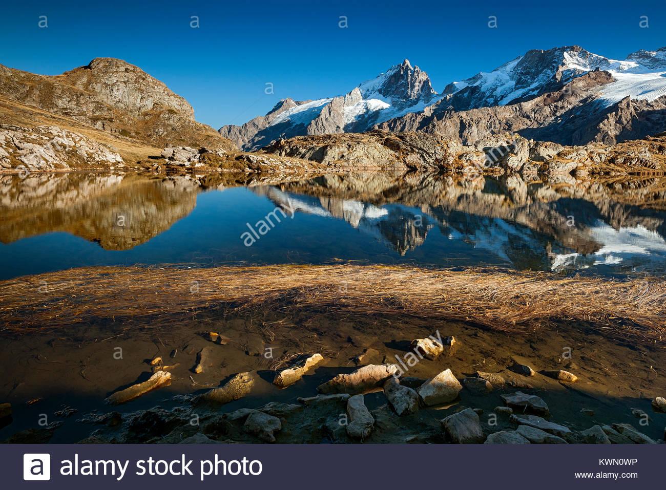 Lake Lérié reflecting La Meije north face in Oisans (Alps - France) Stock Photo