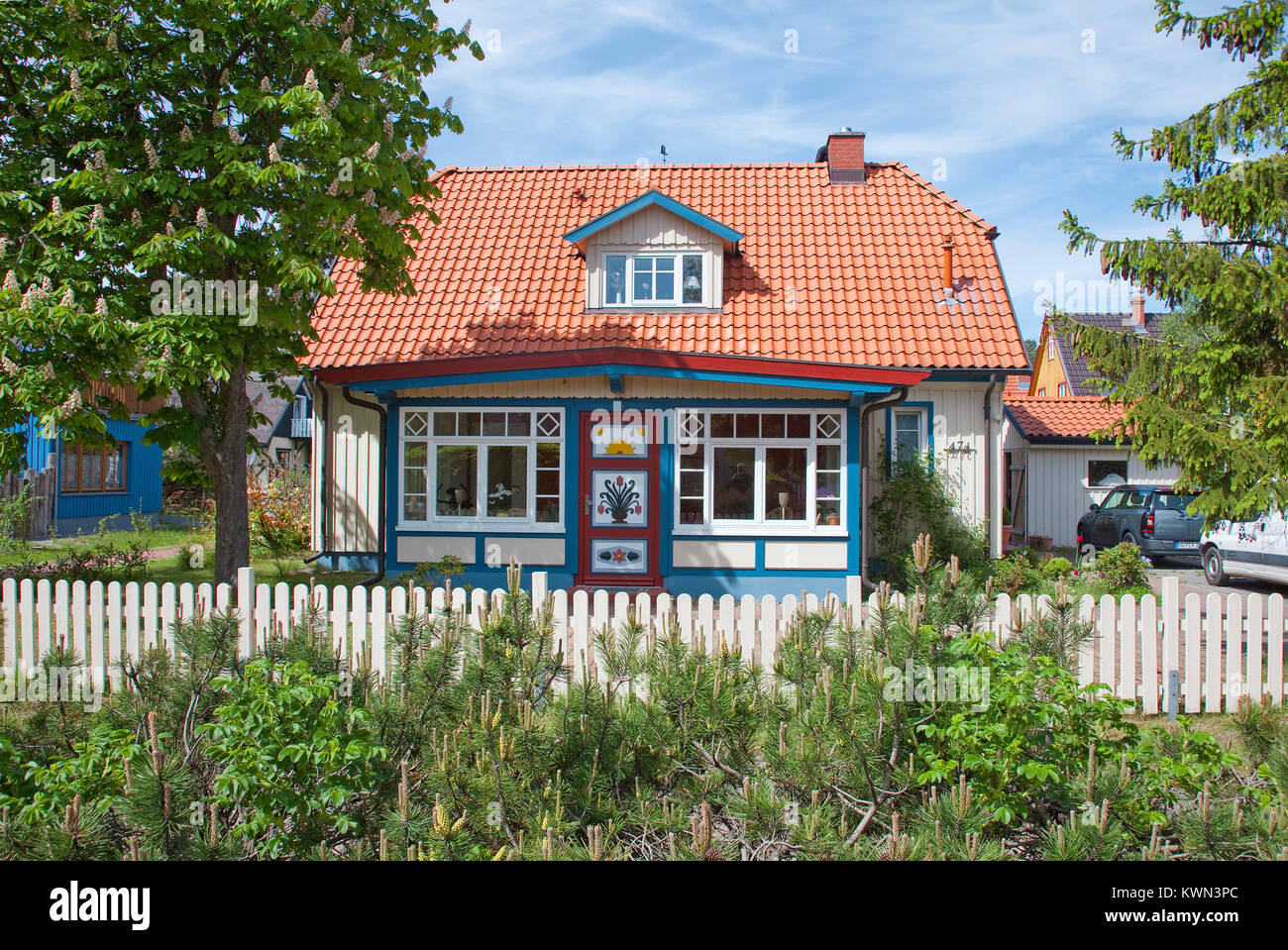Colourful wooden residential house at Prerow, Fishland, Mecklenburg-Western Pomerania, Baltic sea, Germany, Europe - Stock Image