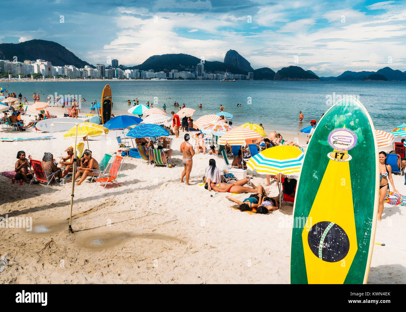 Long board with a Brazilian flag on Copacabana Beach, Rio de Janeiro, Brazil - Stock Image