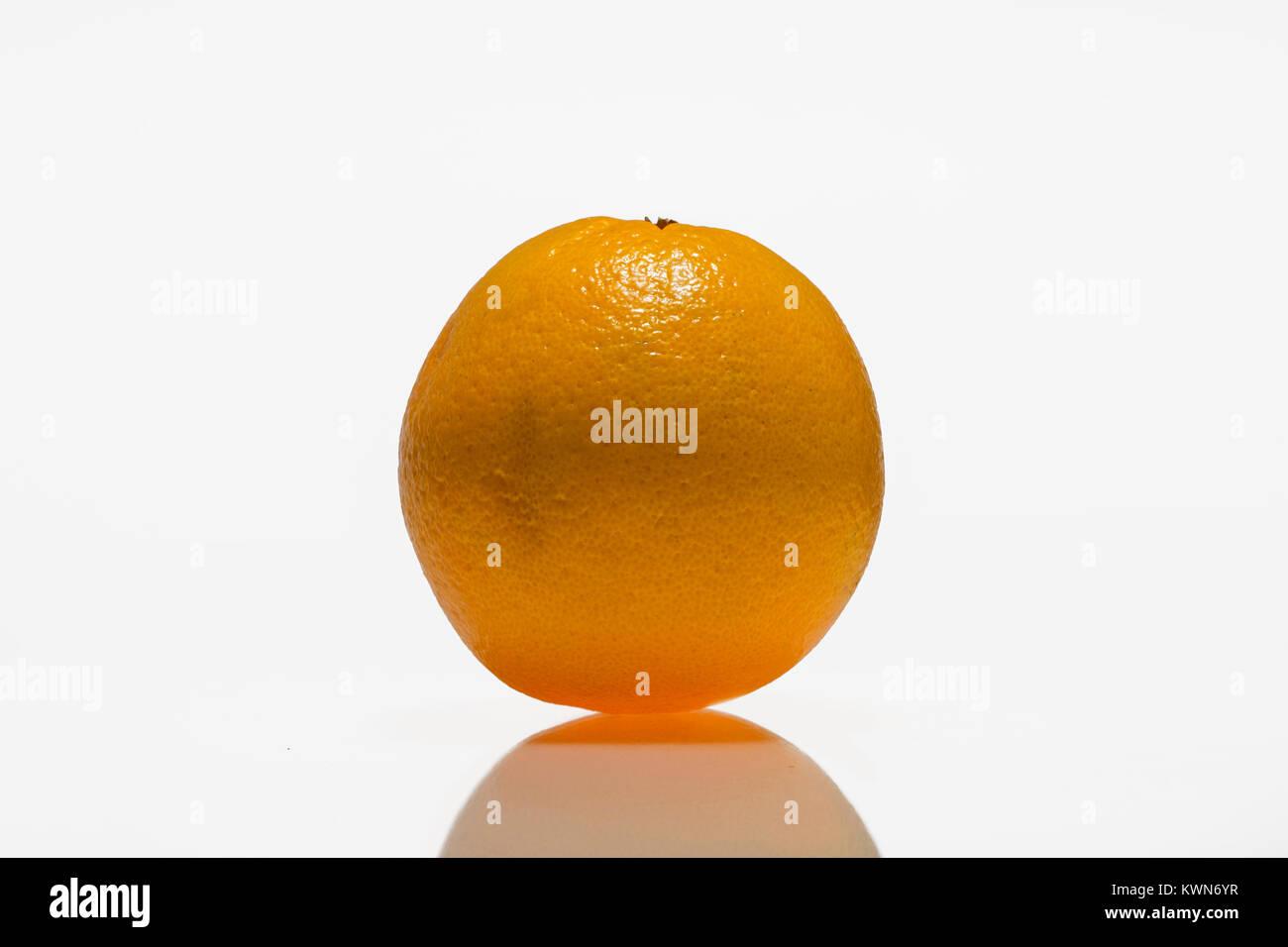 Orange, citrus fruit against white background - Stock Image