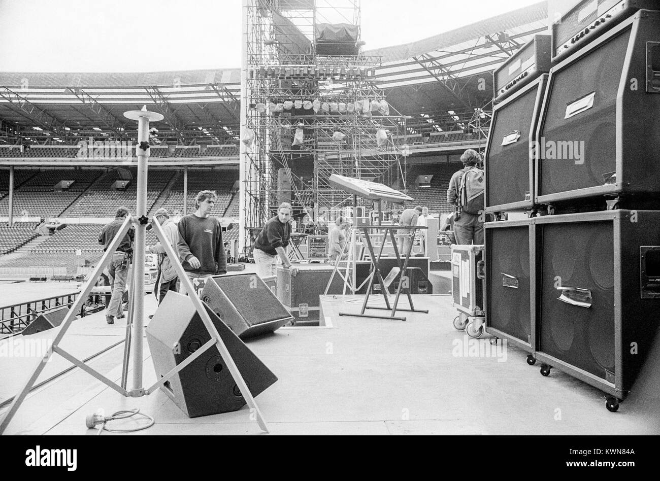 Edwin Shirley Staging crew building a stage in Wembley Stadium for the Jean Michel Jarre concert tour, Europe in - Stock Image