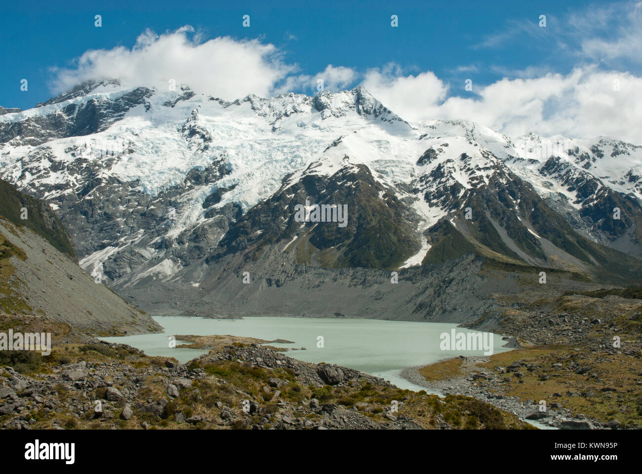 Stunning Hooker Valley, Mueller glacial lake, with snow capped Mount Sefton, in the Southern Alps NZ; sunshine, - Stock Image