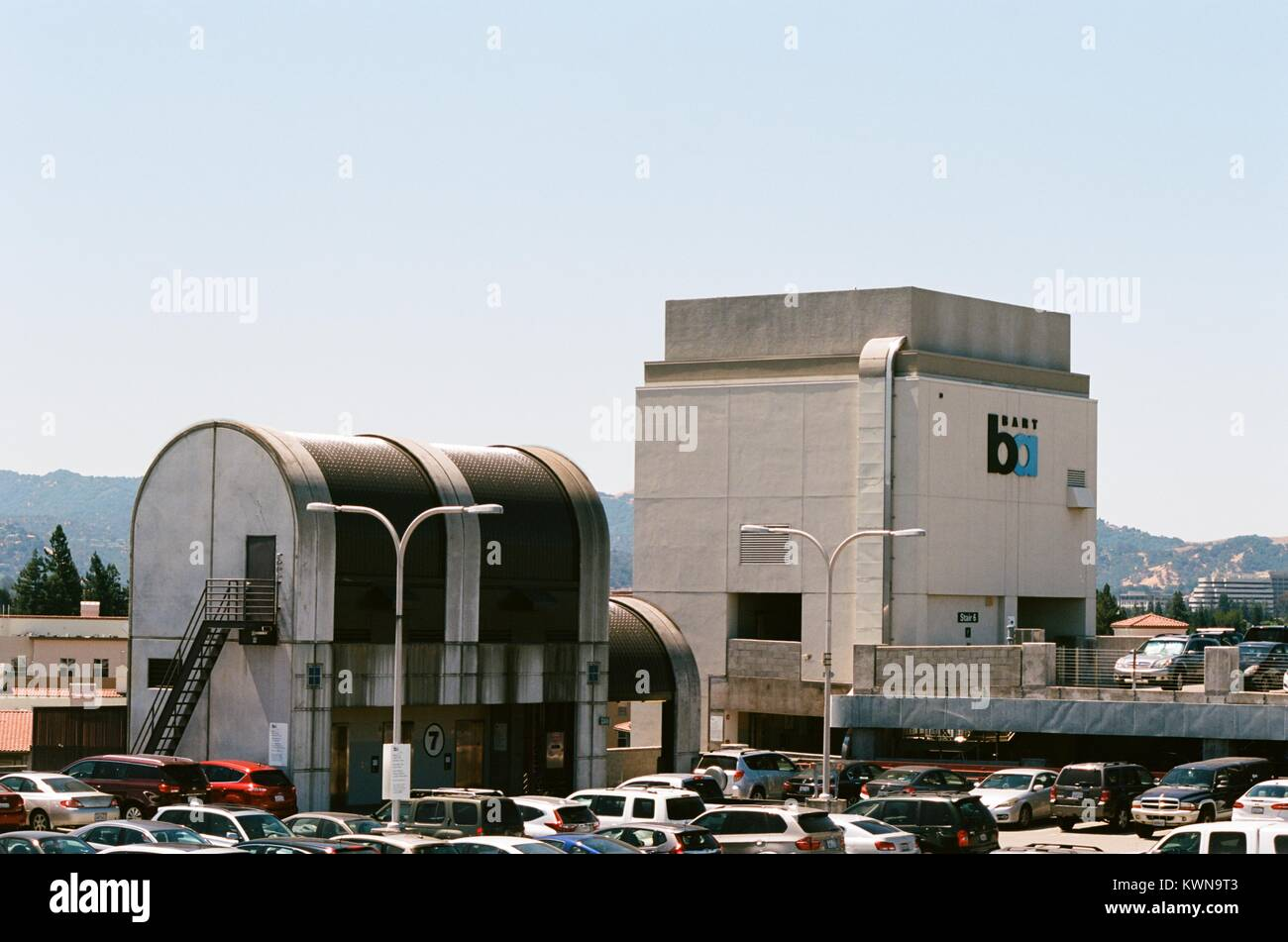Crowded parking lot for the Bay Area Rapid Transit (BART) system at the Pleasant Hill, California station, with - Stock Image