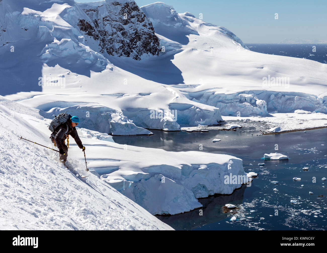 Alpine ski mountaineer skiing downhill in Antarctica; Nansen Island Stock Photo