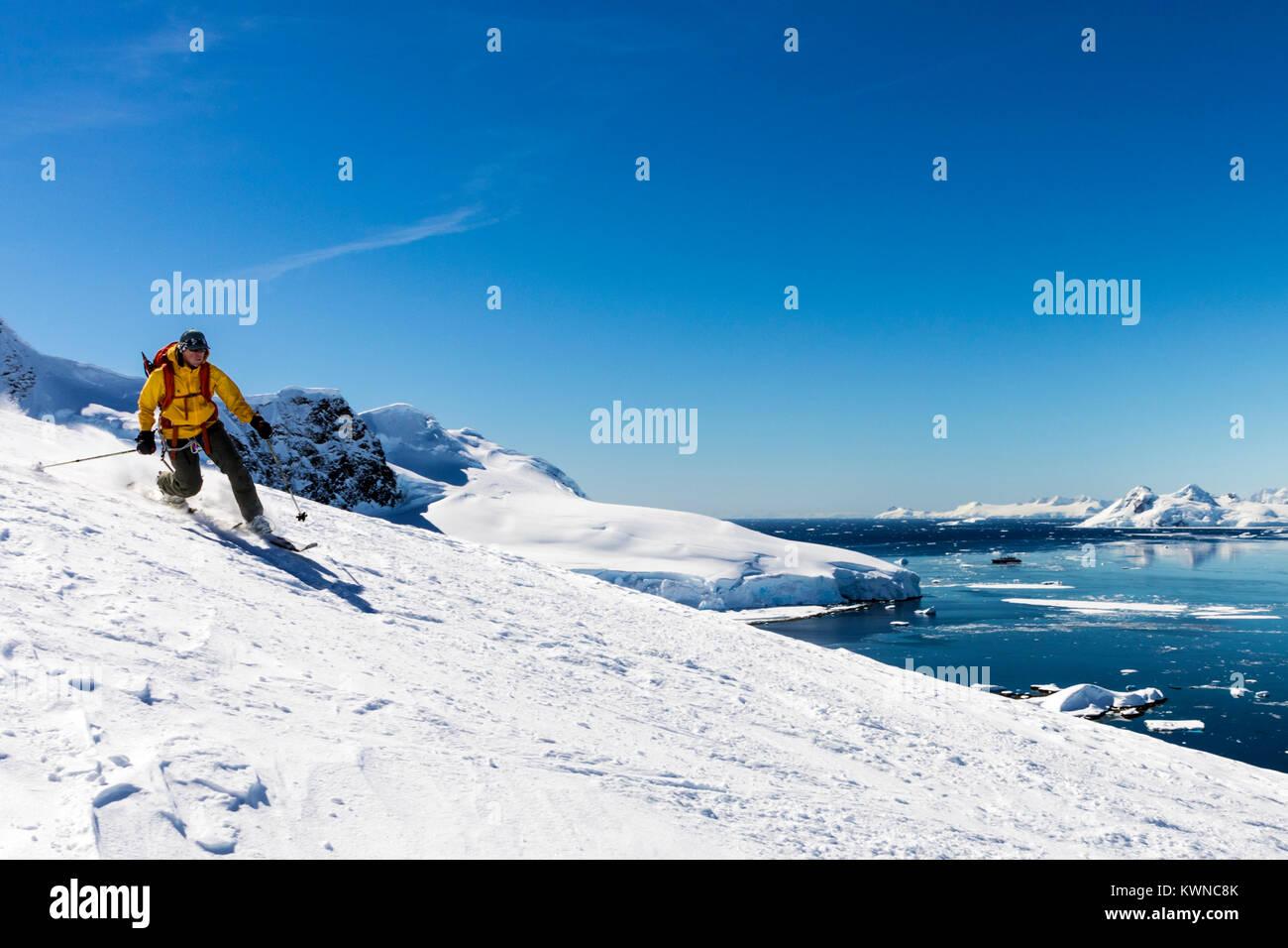 Telemark ski mountaineer skiing downhill; Nansen Island; Antarctica - Stock Image