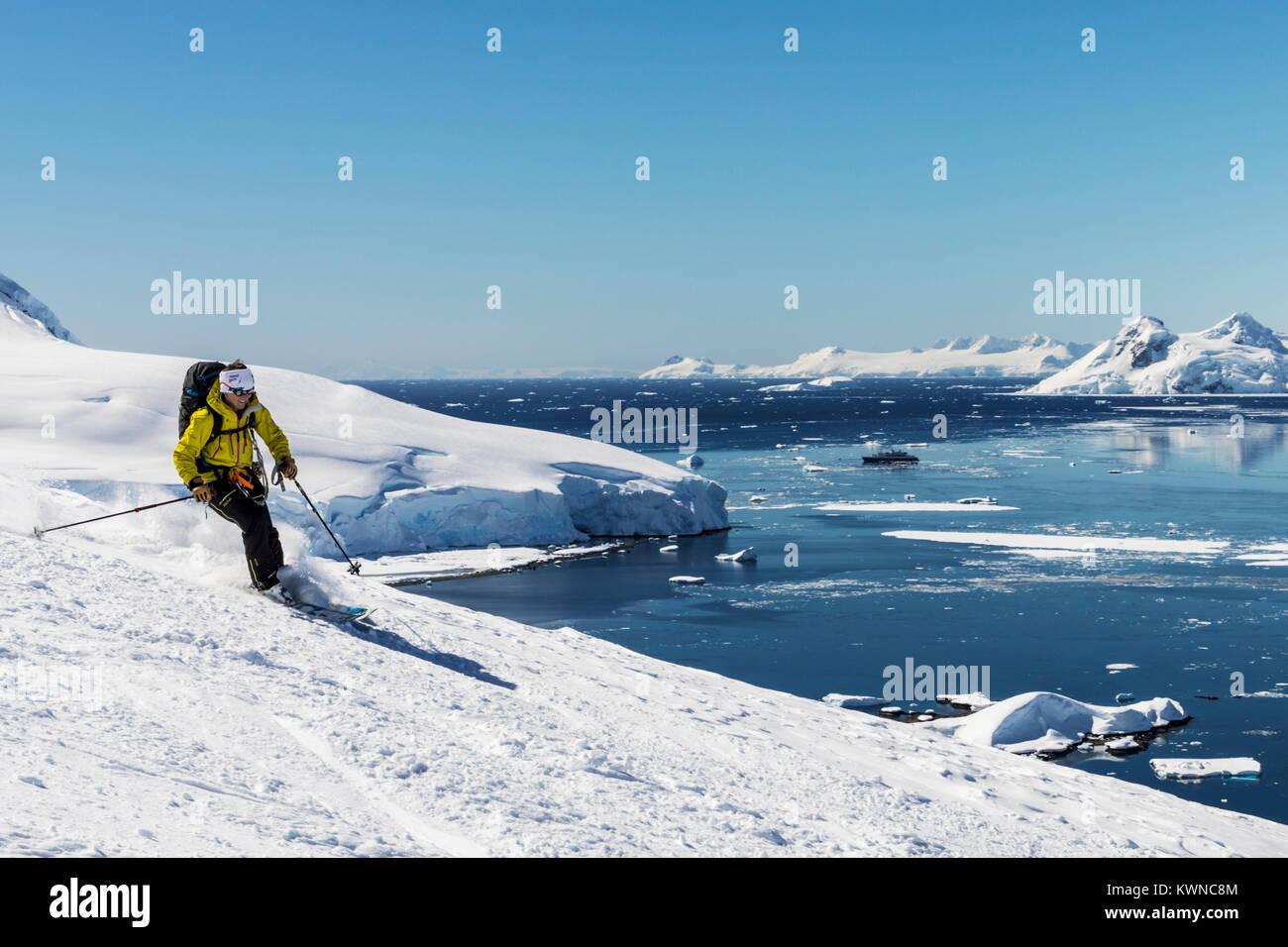 Alpine ski mountaineer skiing downhill; Nansen Island; Antarctica - Stock Image