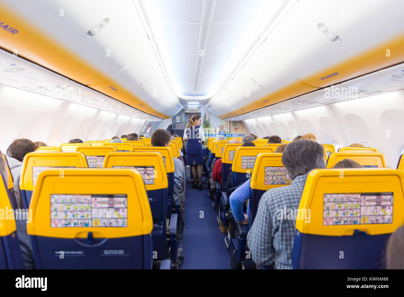 Stewardess serving passangers on Ryanair airplane flight on 14th of December, 2017 on a flight from Trieste to Valencia. - Stock Image