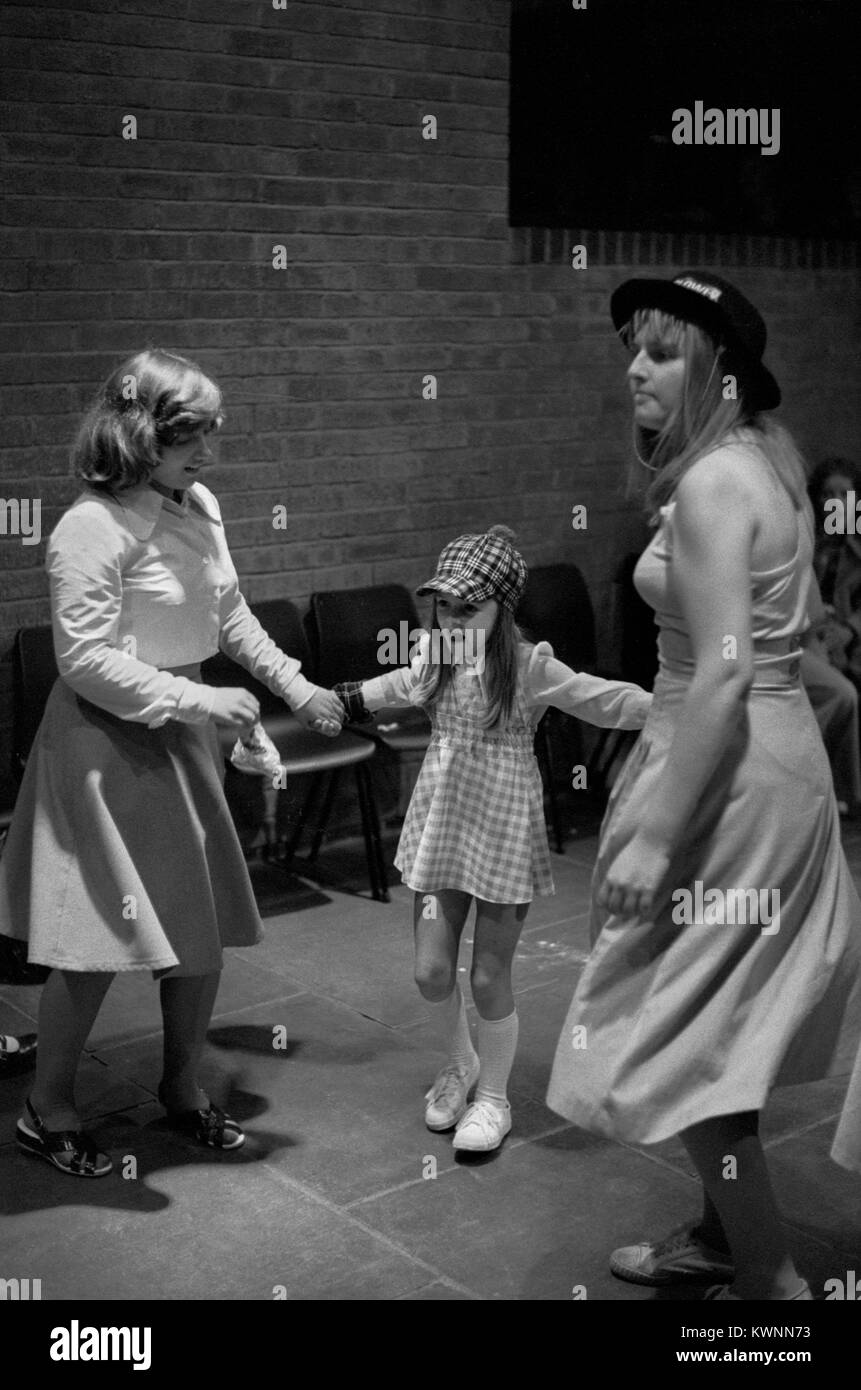 Teenager girls dancing together at a 1970s Youth Club disco UK 70s Britain HOMER SYKES - Stock Image