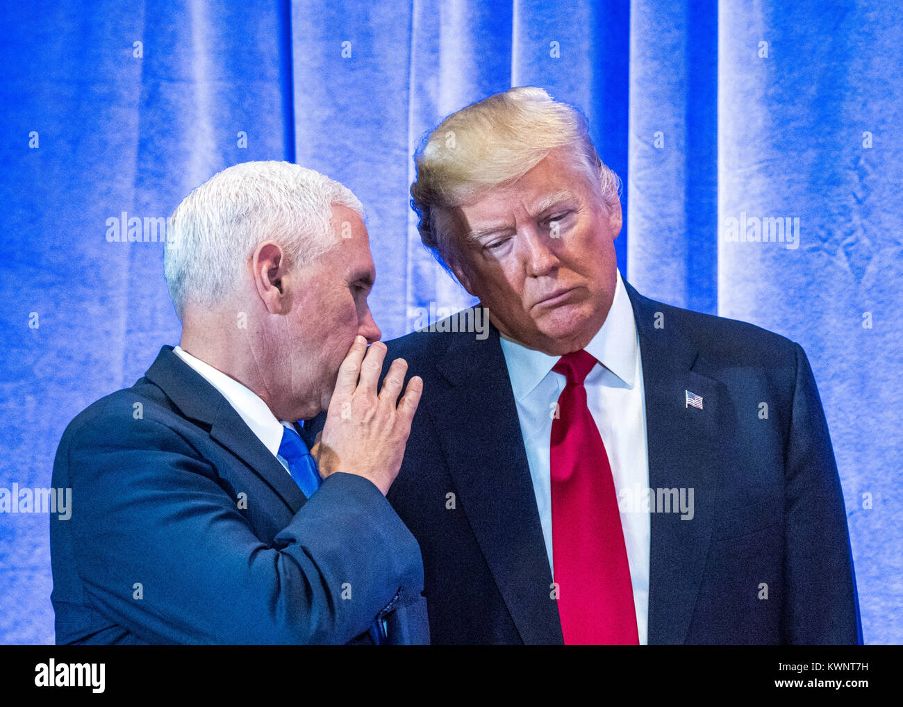 New York, USA, 11 January 2017.  US President-elect Donald Trump (R) listens to his Vice-President-elect Mike Pence before a news conference in New Yo Stock Photo