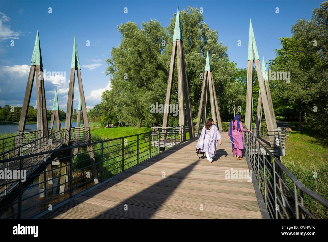 Berlin. Germany. Wooden bridge in the Britzer Garten, Neukölln. - Stock Image