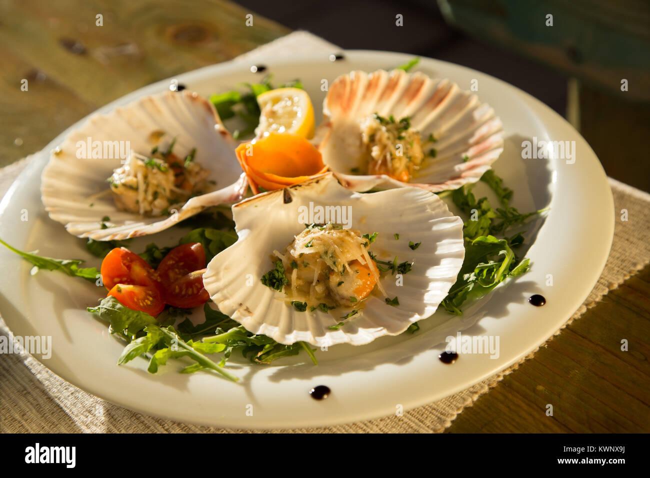Scallops, restaurant Croatia. - Stock Image