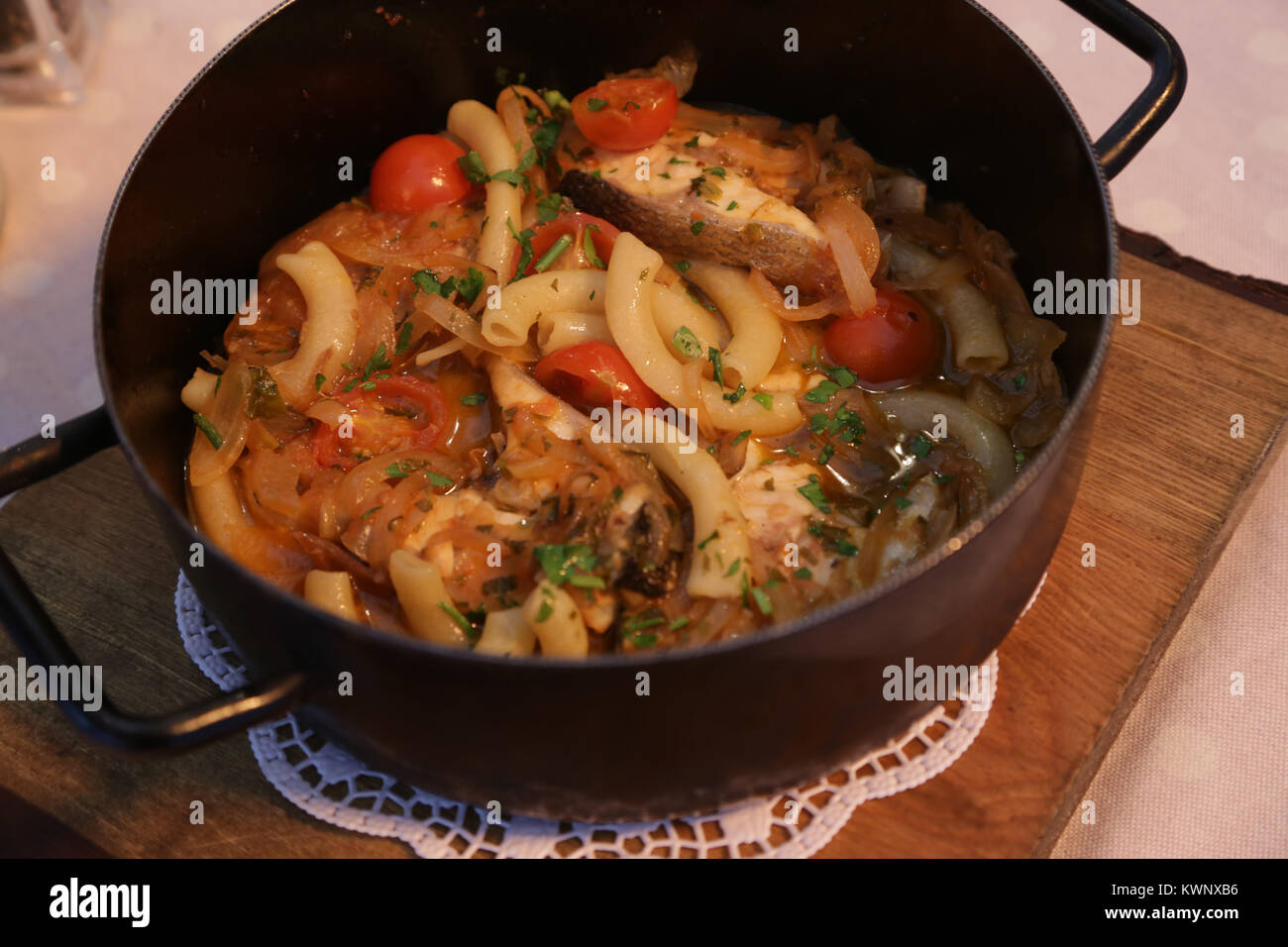 Tećada with sea food and macaroni, traditional Croatian dish - Stock Image