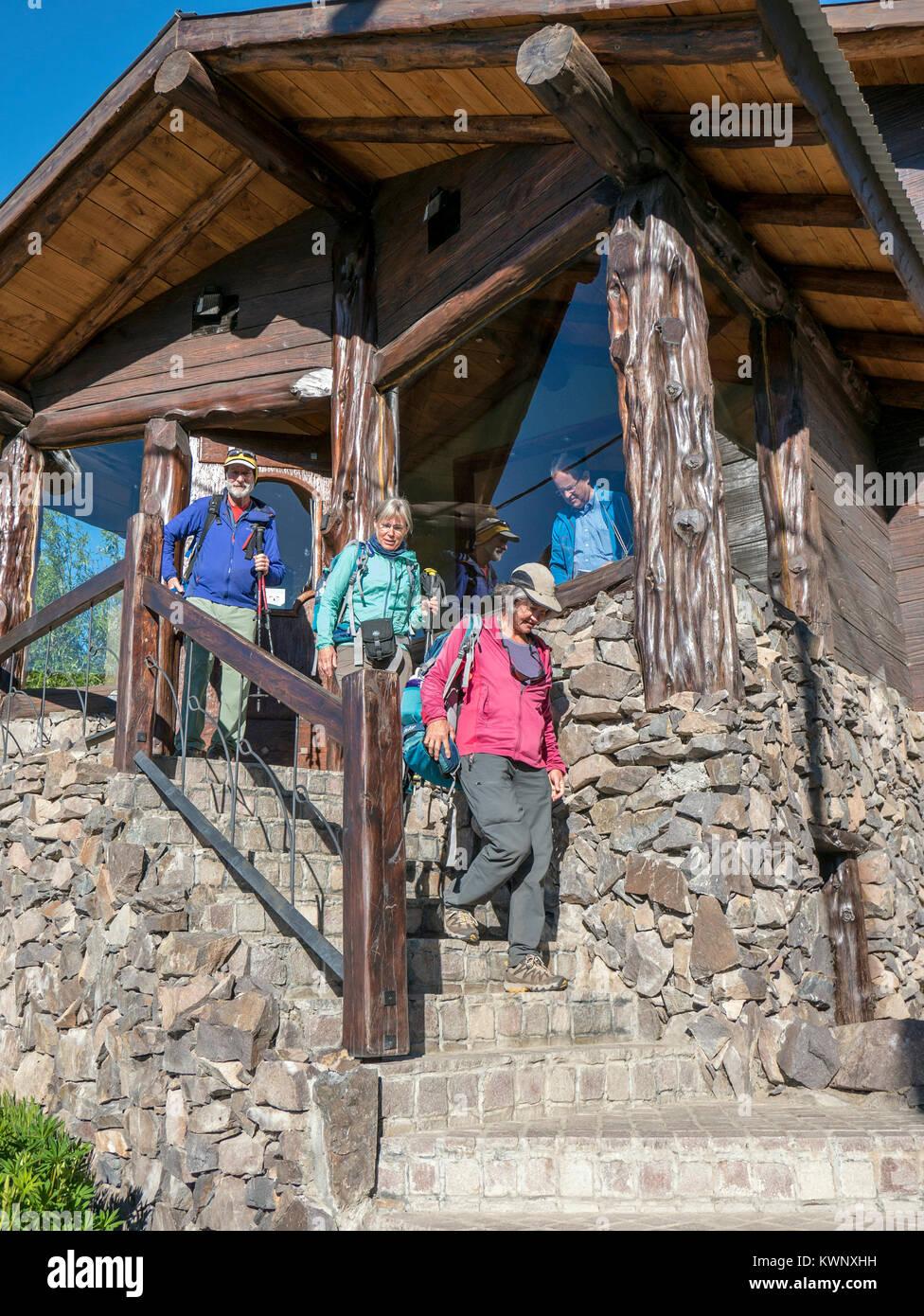 Travelers exit Infinito Sur hotel & lodge; El Chaltén; Chile - Stock Image