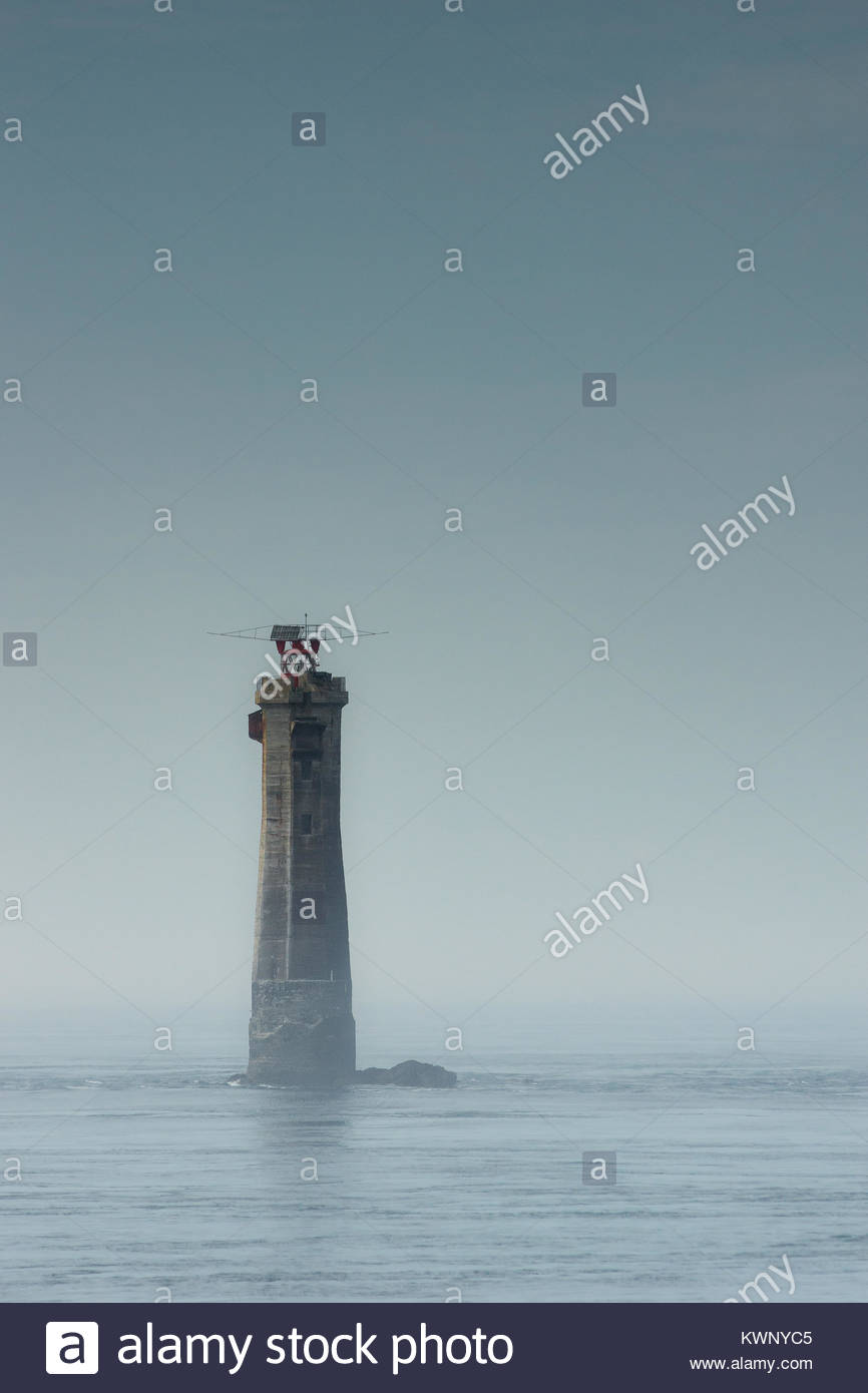 Ouessant island in Brittany (France) - the Phare du Nividic lighthouse, at Pointe du Pern, in the morning mist Stock Photo