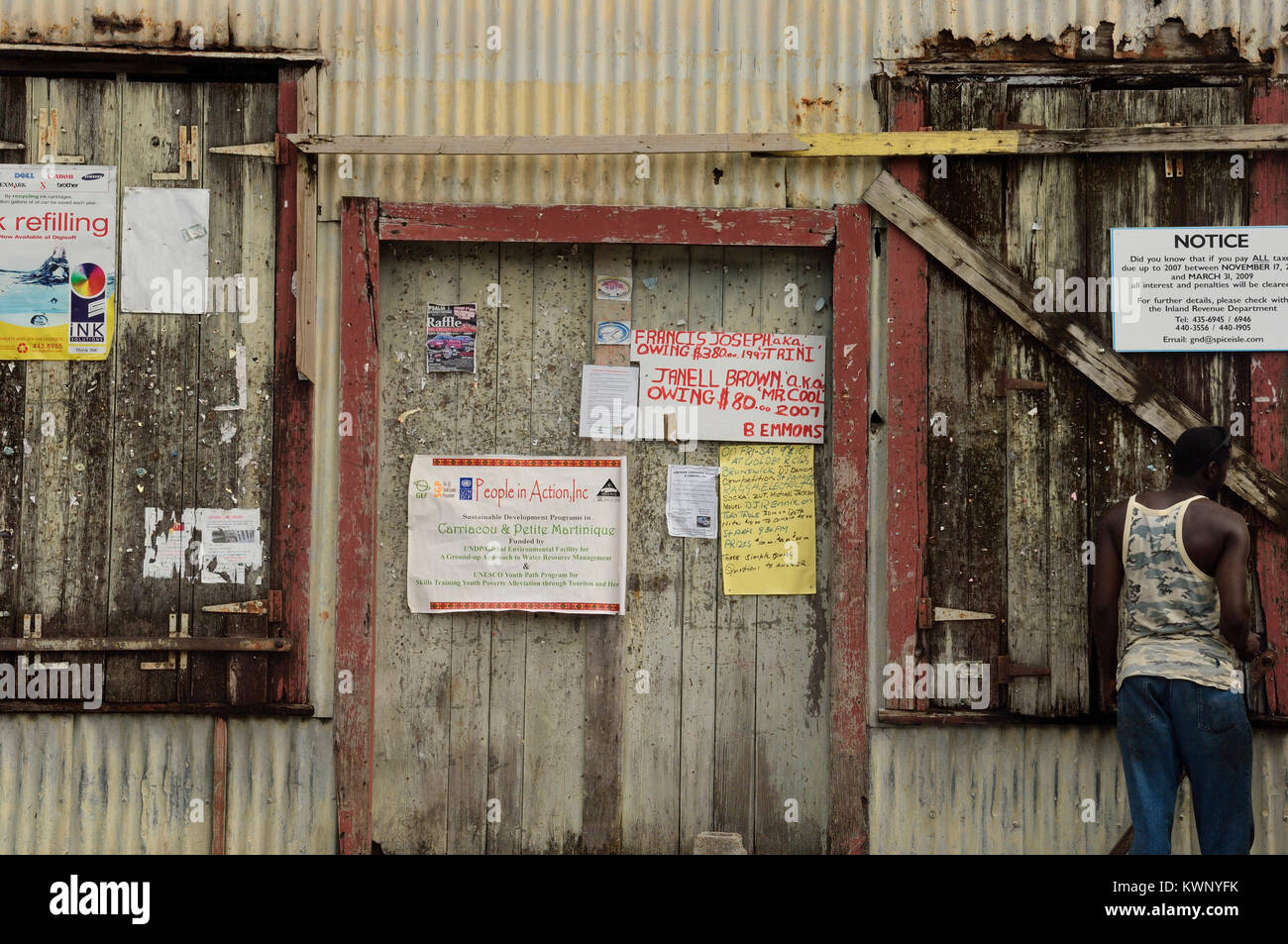 Notices pinned to an old building,Hillsborough, Carriacou, Grenadine Islands, Caribbean - Stock Image