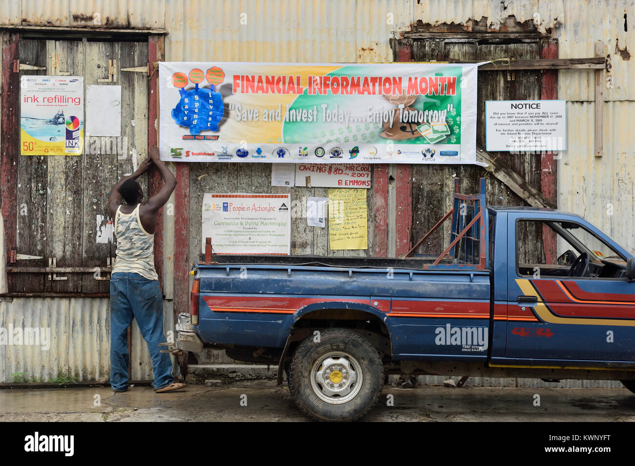 Notices and advertising pinned to an old building,Hillsborough, Carriacou, Grenadine Islands, Caribbean - Stock Image